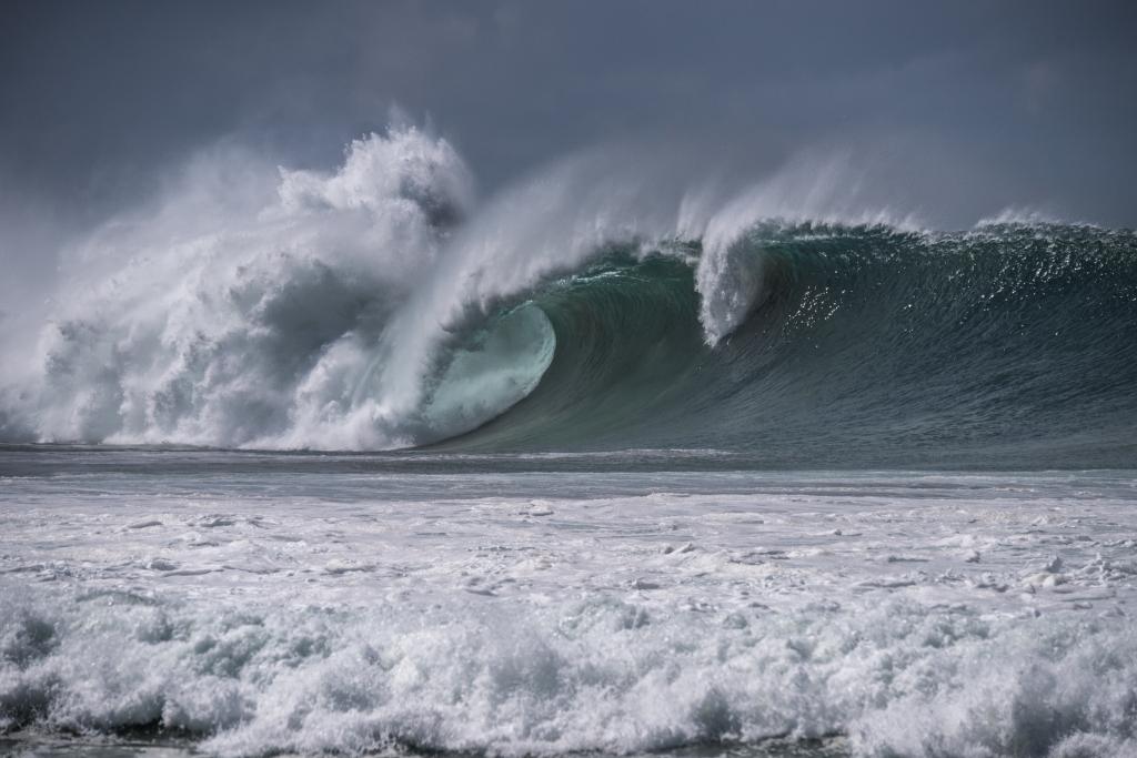 Wave breaking over Little Henty Reef