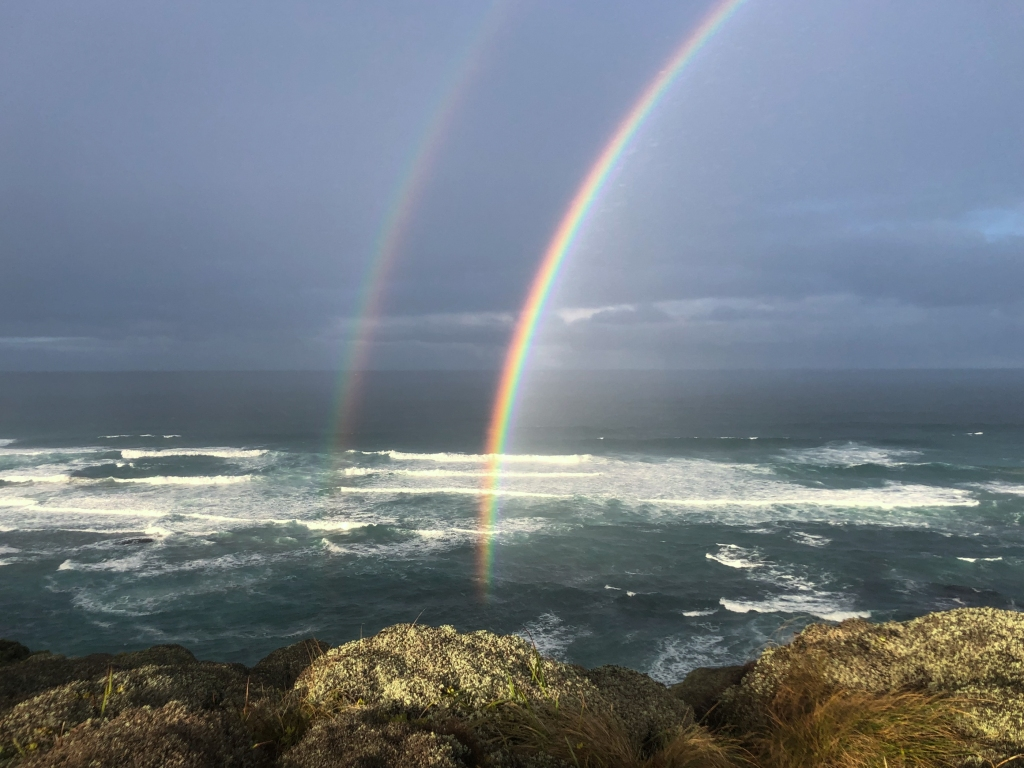 Rainbow over surf at Gibson Steps