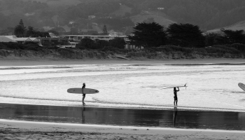 Longboarders at sunset Apollo Bay