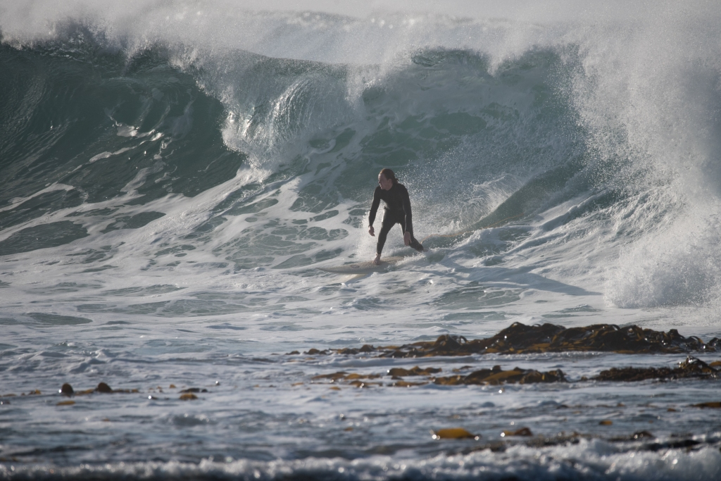 Surfer on double overhead wave at Hayley Point