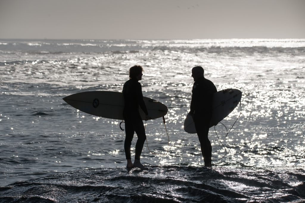 Surfer silhouettes at Hayley Point