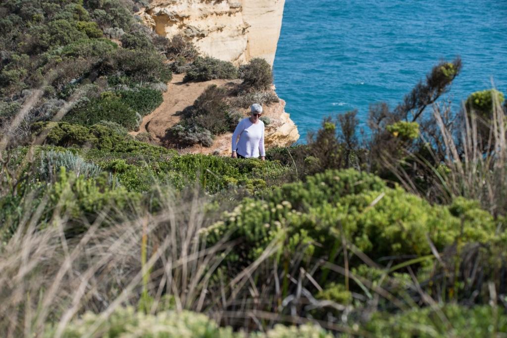 Liz walking on shipwreck coast cliffs