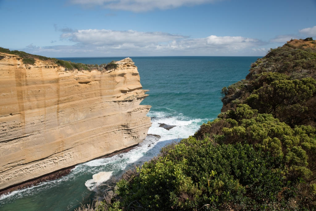 Small bay surrounded by limestone cliffs on Great Ocean Road