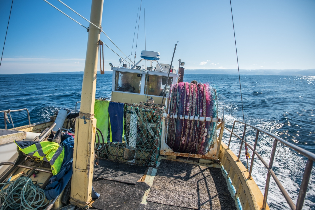 Cray boat with nets on spool on deck