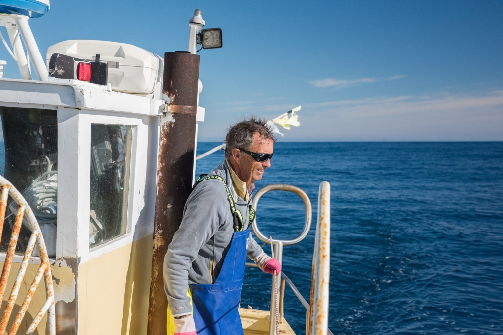 Deck hand on the Karlene-Marie at sea