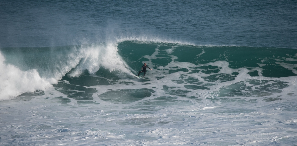Surfer riding big wave at Gibson Steps