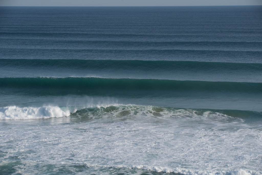 Perfect lines of big swell at Gibson Steps