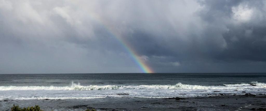 Rainbow and storm cloud