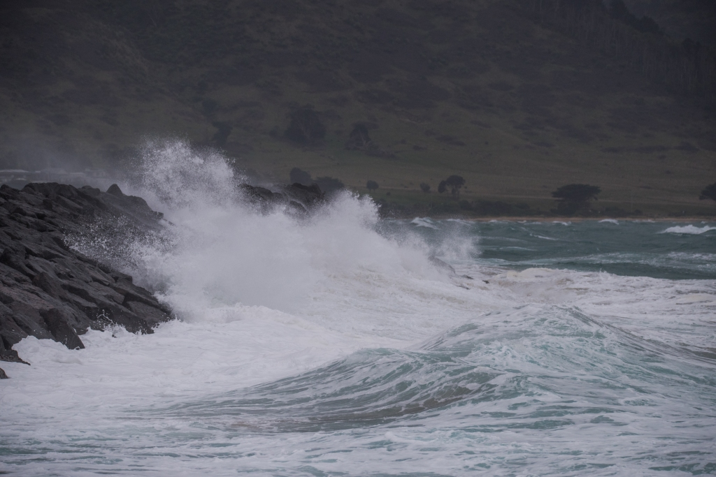 Waves breaking over harbour wall at Apollo Bay