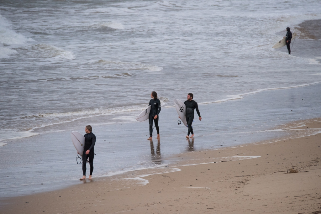 Surfers on west coast beach