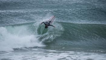 Surfer smashing wave lip