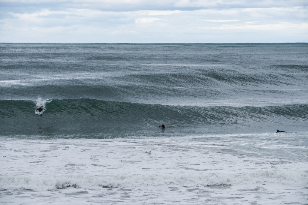 Surfers in glassy west coast swell