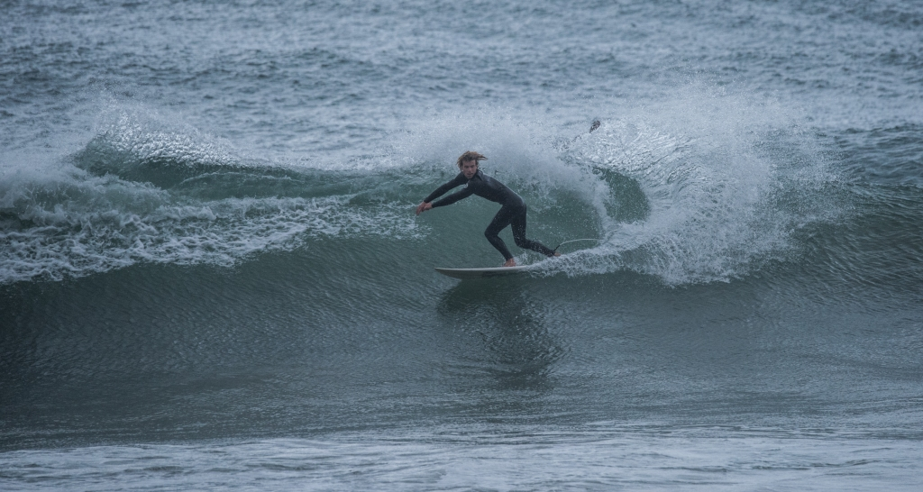 Surfer in glassy west coast swell