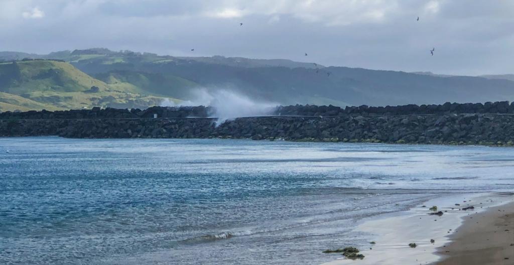 Easterly waves breaking over the breakwater