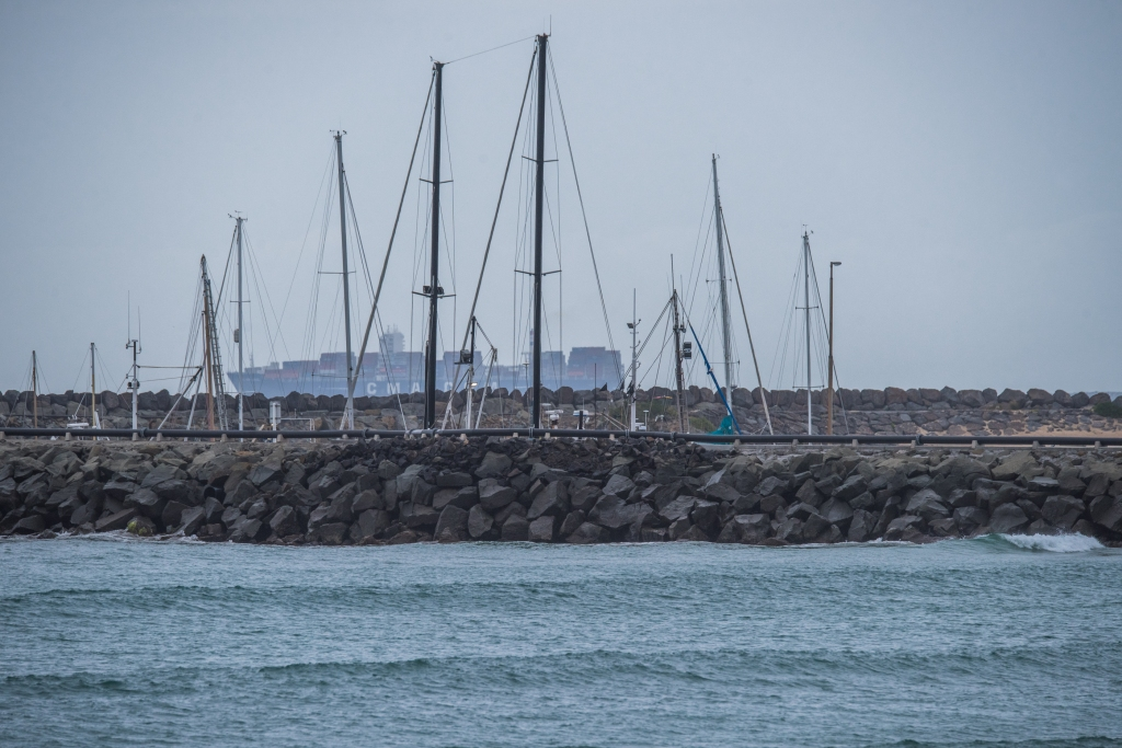Apollo Bay harbour and passing ship