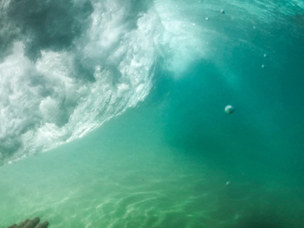 Breaking wave seen from underwater