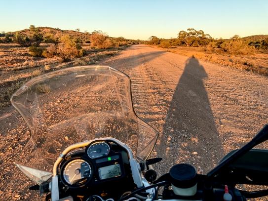 BMW R1200GS dirt road dawn
