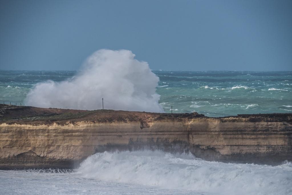 Big surf breaking over cliffs at Broken Head near Twelve Apostles