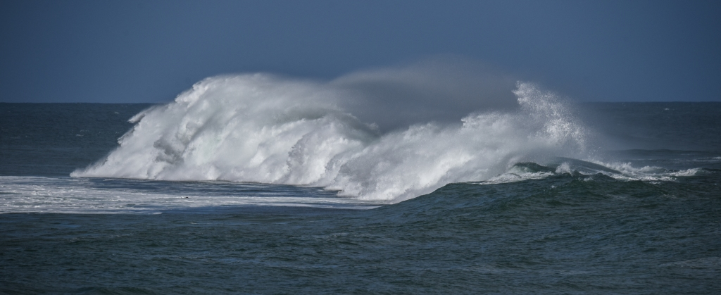 Breaking  large wave - four photos