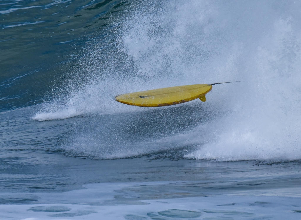 Surfboard on a wave without a rider