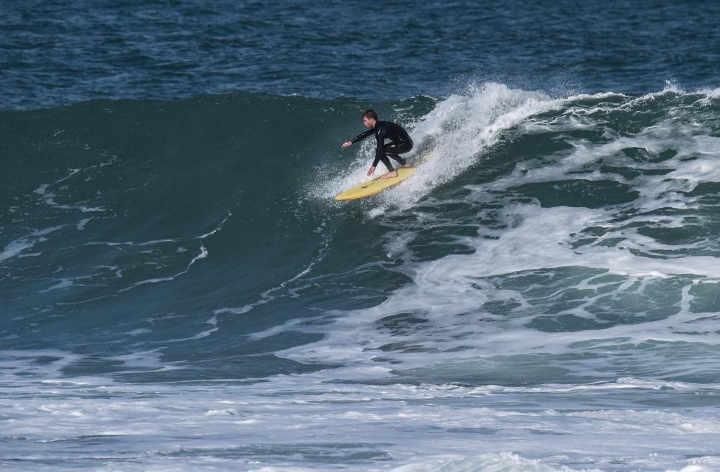 Surfer on large wave