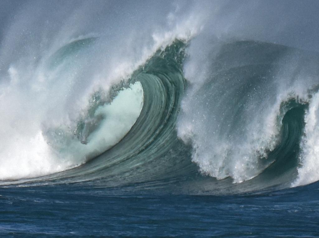 Barrel on breaking large wave