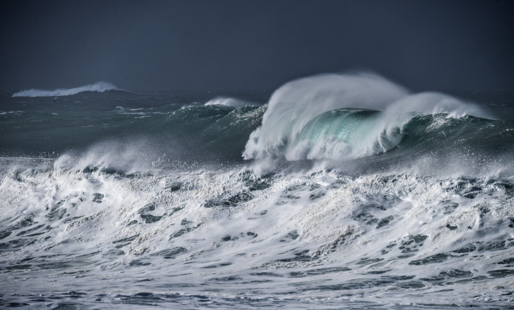 Sunlit big winter wave on the west coast of Victoria