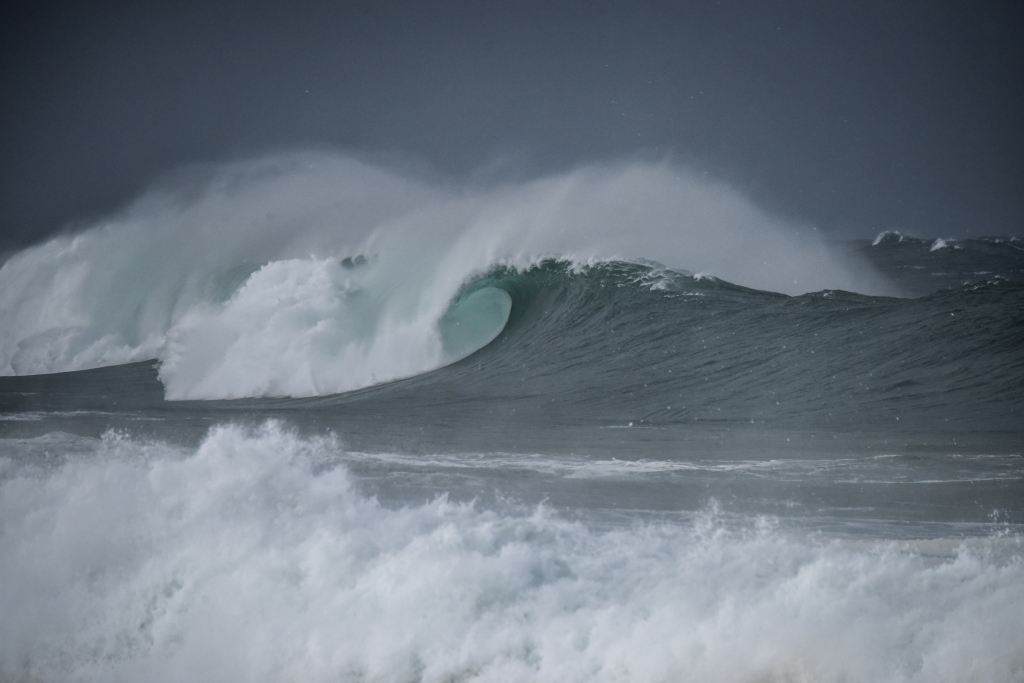 Barrel on big winter waves breaking on the west coast of Victoria