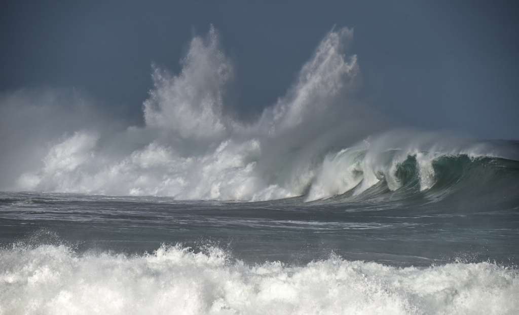 White water flying high on big winter waves breaking on the west coast of Victoria