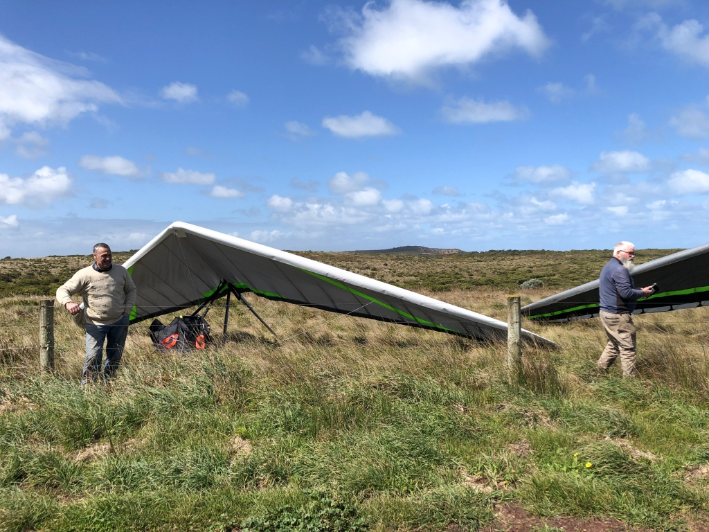 The landing paddock with hang gliders and pilots