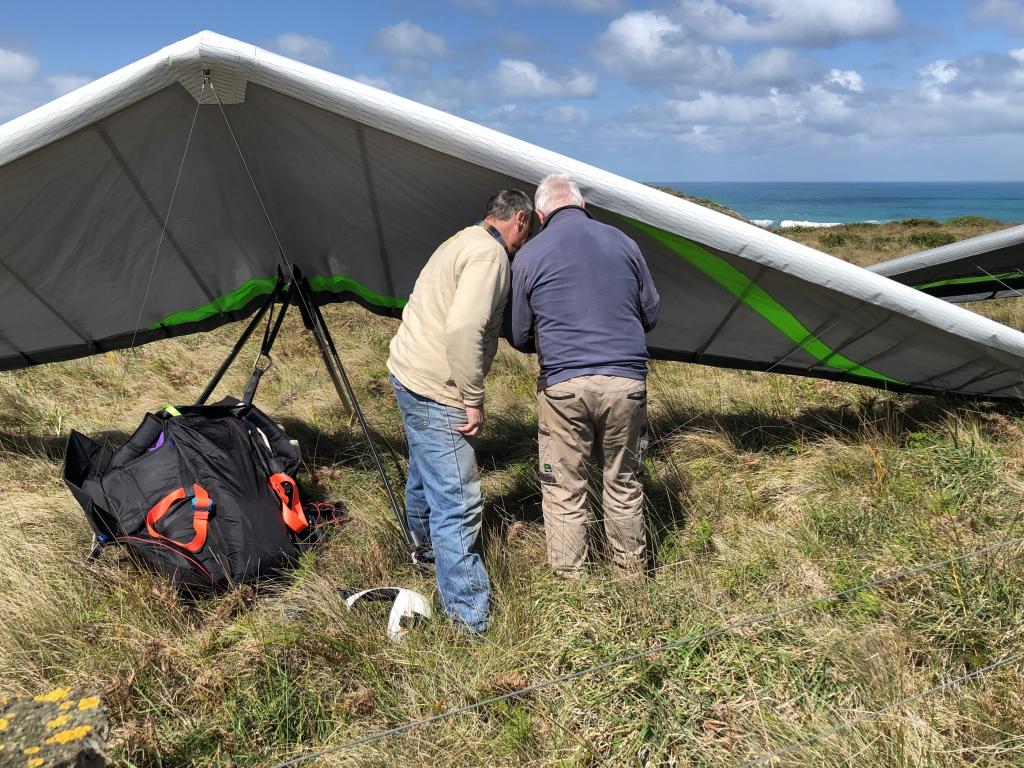 In the landing paddock after landing hang gliders