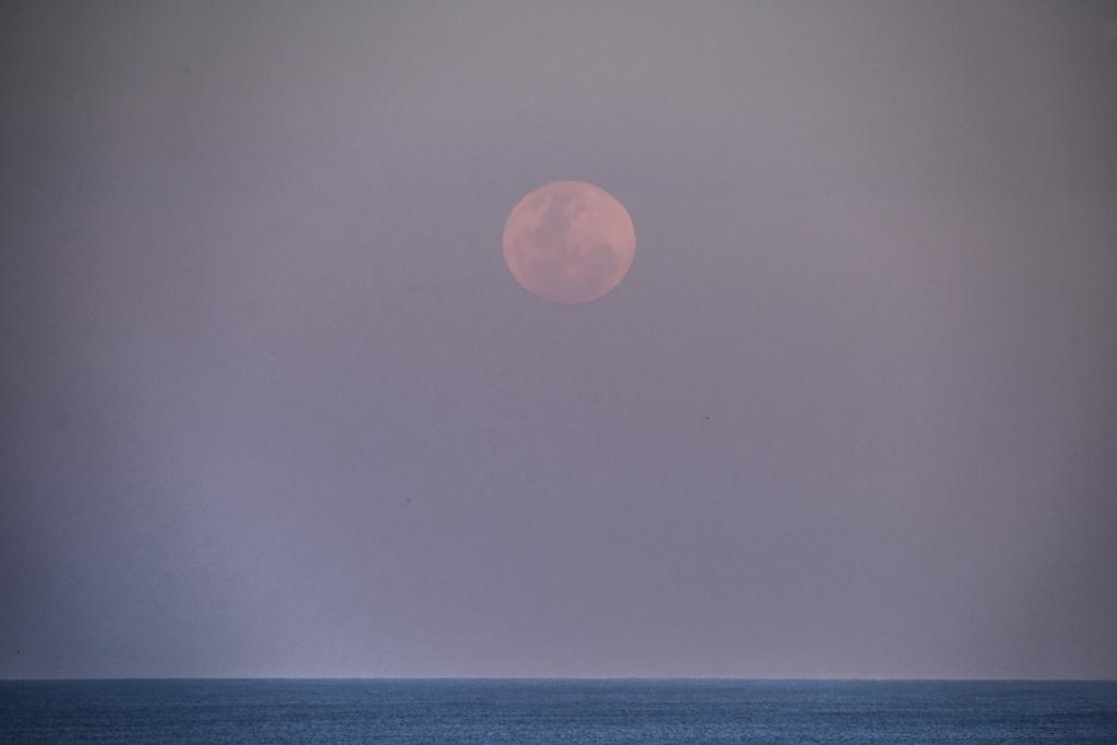 Full moon rising over Bass Strait