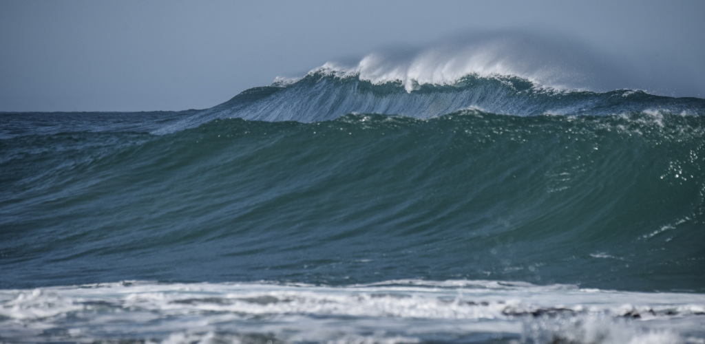 Large wall of a wave starting to break