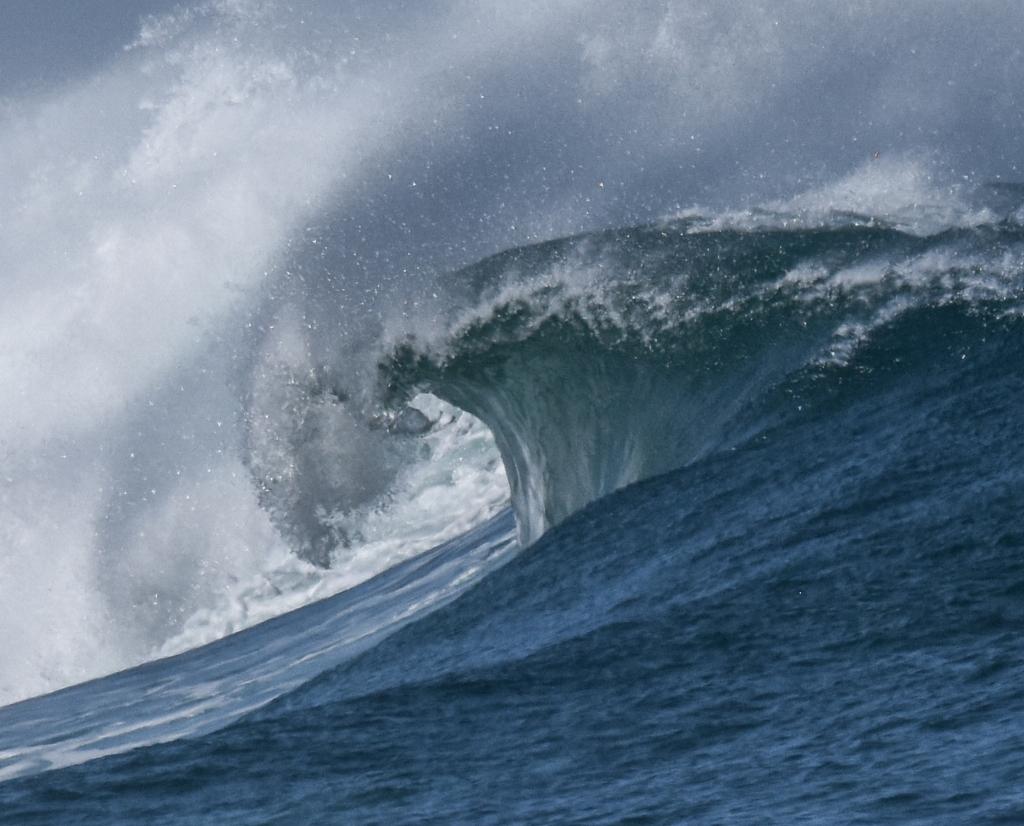 Closeup of barrel forming inside a breaking wave