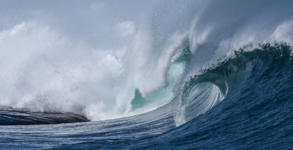 Big wave breaking over exposed rock on Little Henty Reef near Marengo.