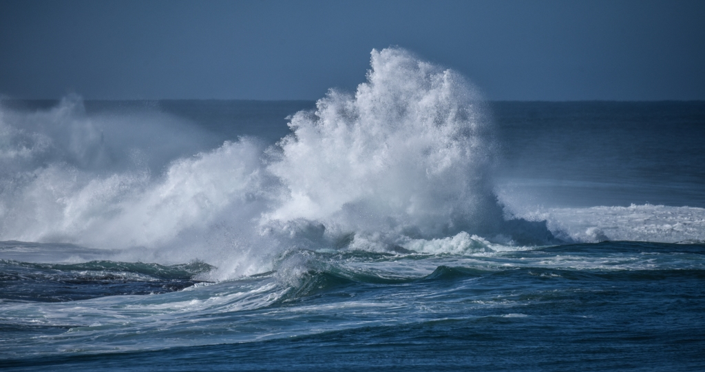 White water expoiding up as wave breaks on Little Henty Reef near Marengo