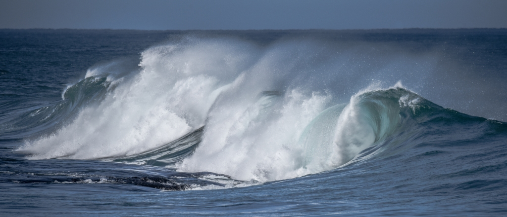 Small but intense wave breaking on exposed reef