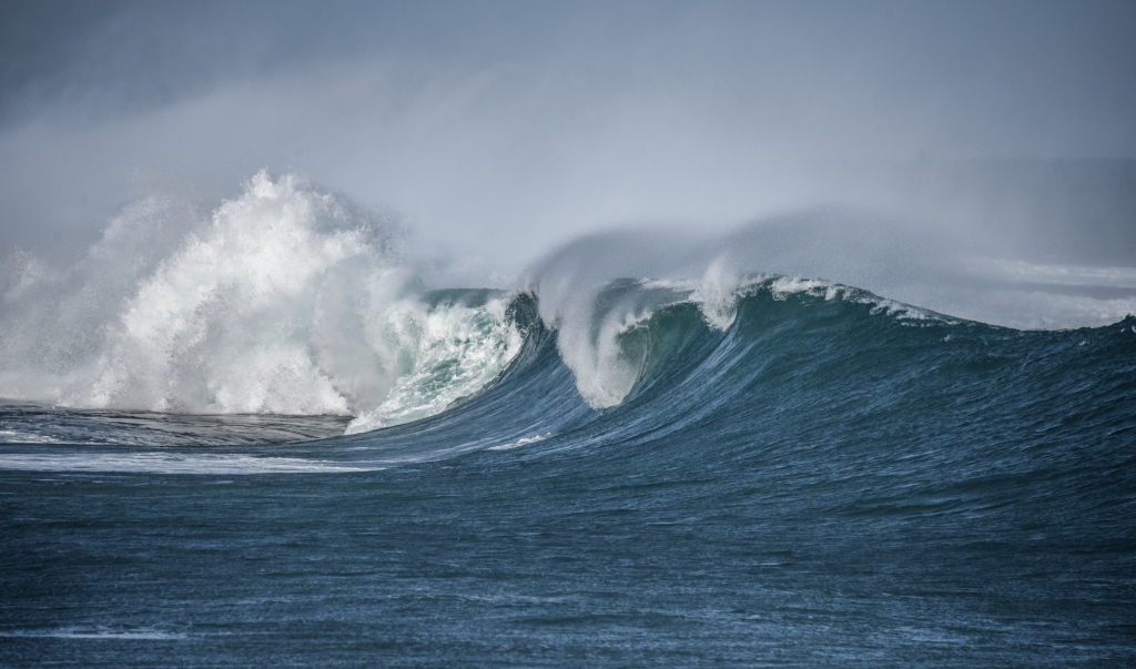 Large wave breaking over exposed reef