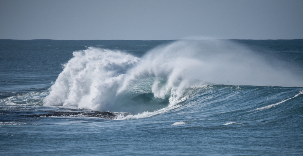 Moderate wave breaking on visible reef