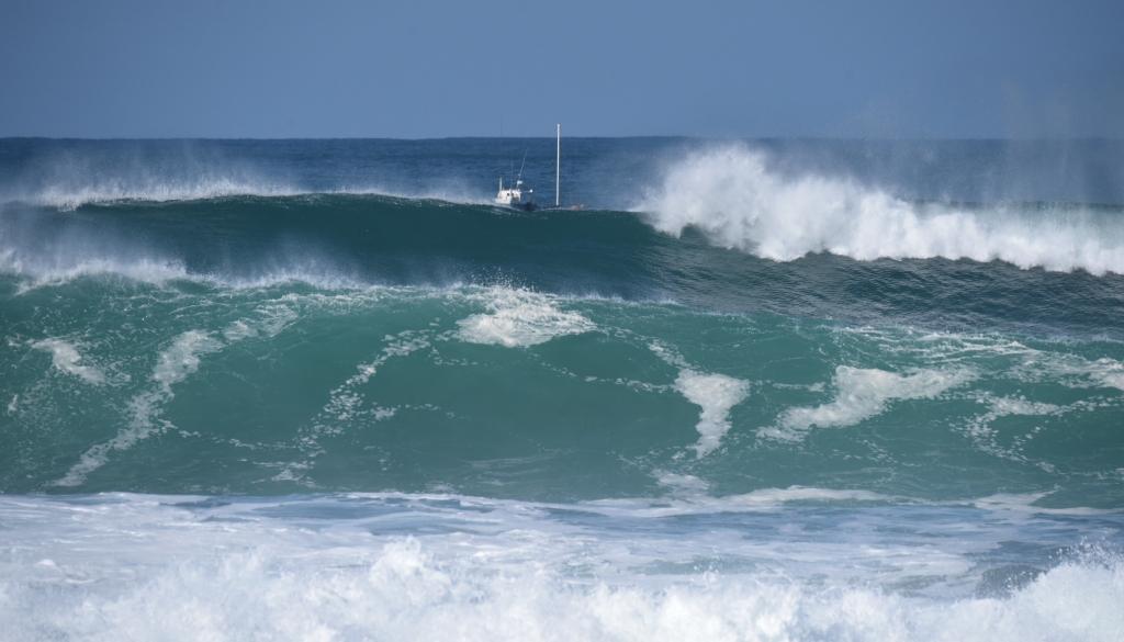 Crayfish boat near breaking waves