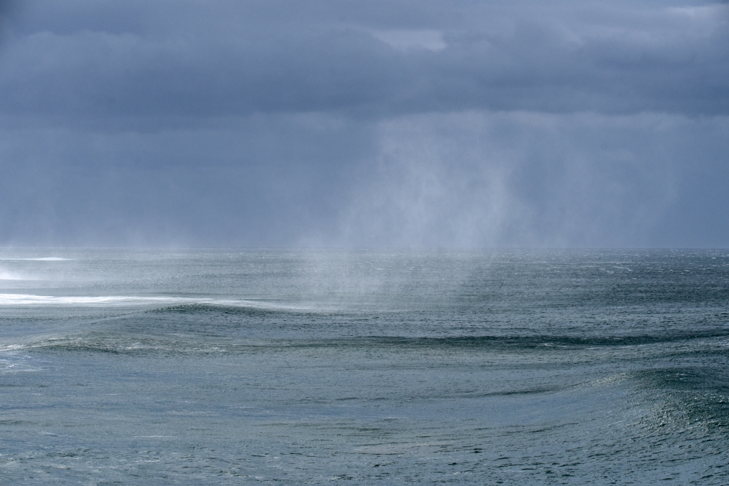 Spray from waves blown over 100 feet in the air by turbulent strong winds from over the Otway Ranges
