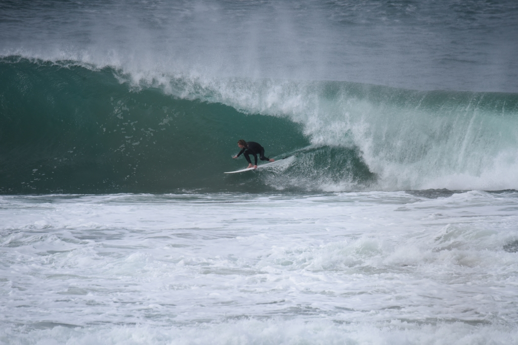 Surfer pulling into a barrel