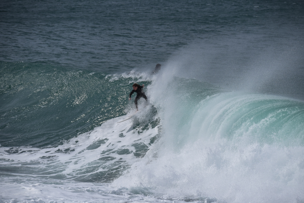 Surfer on a right hand point break