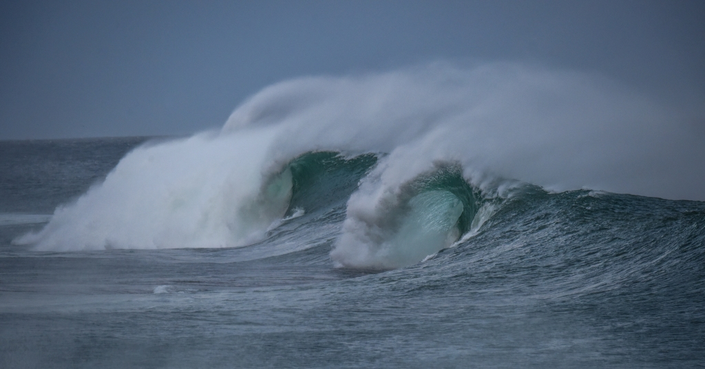 Two barrels on one breaking wave at Little Henty Reef
