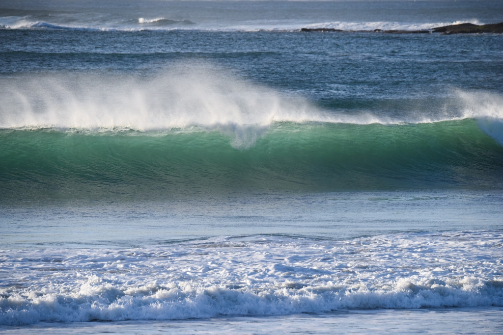 Breaking wave at dawn