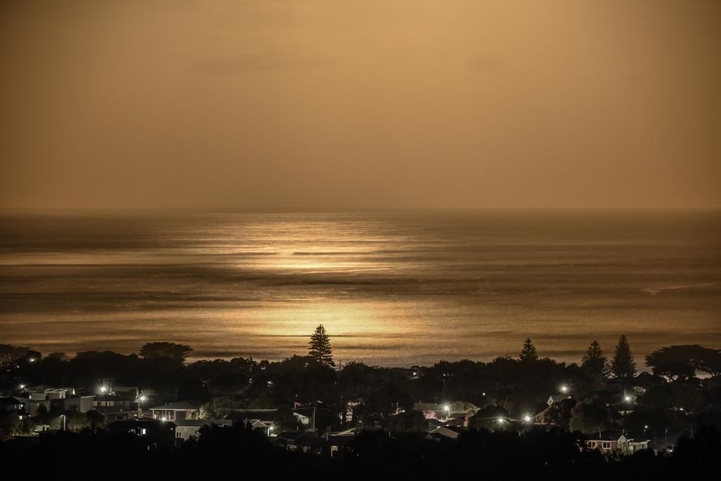 Golden moonlight over Bass Strait