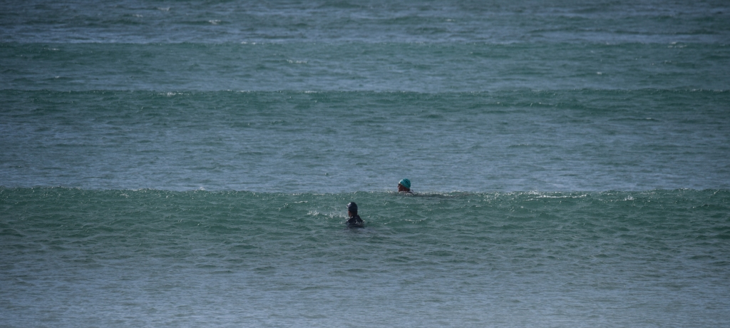Ocean swimmers at Apollo Bay, in swell