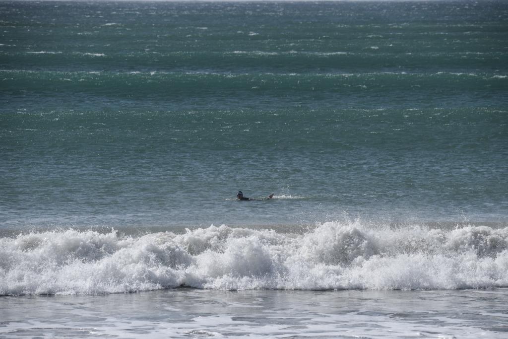 Solo ocean swimmer at Apollo Bay in swell