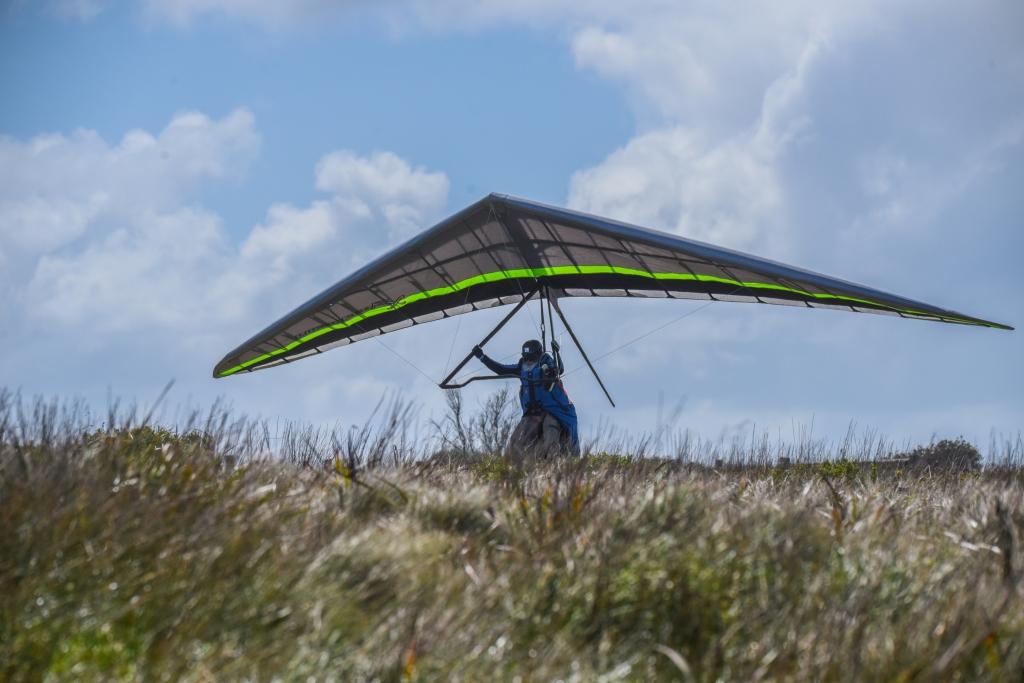 Hang gliding flaring on landing
