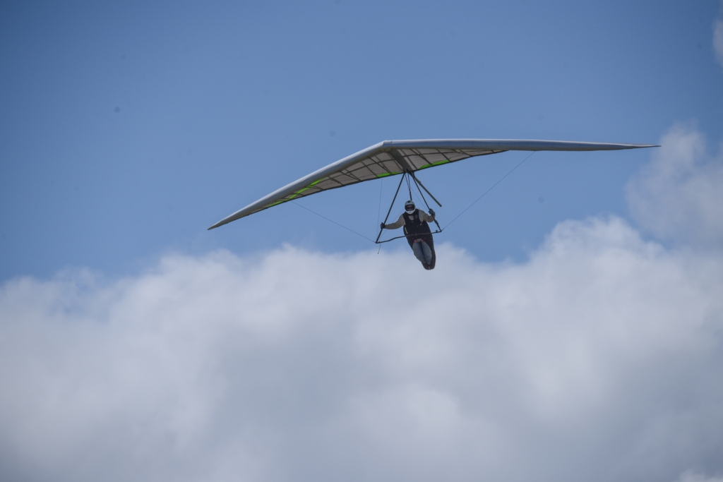 Hang glider and clouds